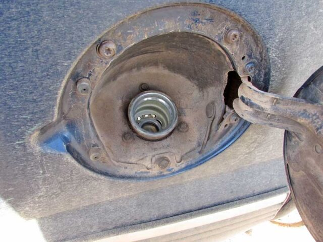 Clean the area around the fuel tank cap